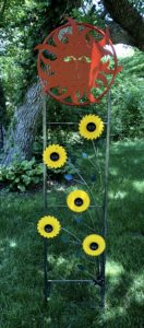 "SALE 15% Off. Sun with Sunflowers. 77"" x 22"" x 24"". $345. Available at Noyes Art Gallery, 119 S. 9th, Lincoln, NE 68508, 402-475-1061."