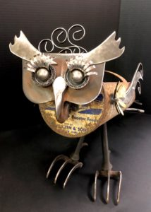 """Amelia Owl"" $175. 28"" x 8"" x 16"" 7 lbs., available at Noyes Art Gallery, 119 S. 9th, Lincoln, NE 68508, 402-475-1061. Materials: grain scoop, ball bearings, tube bender springs, motor hoe, saw blades, candle holders, brass pine cone, tin ships, wire brushes, tin, carriage bolts, nuts, washers."