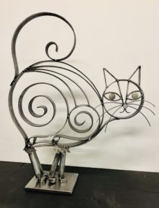 """Puddy Cat"" 17"" x 20 1/2"" x 5"" 9 lbs. $110, available at Noyes Art Gallery, 119 S. 9th, Lincoln, NE 68508, 402-475-1061. Materials: Flat metal bar stock, pipe punch outs, pipe, scrap plate steel, clear coat."